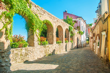 Old European Street With Stone Wall