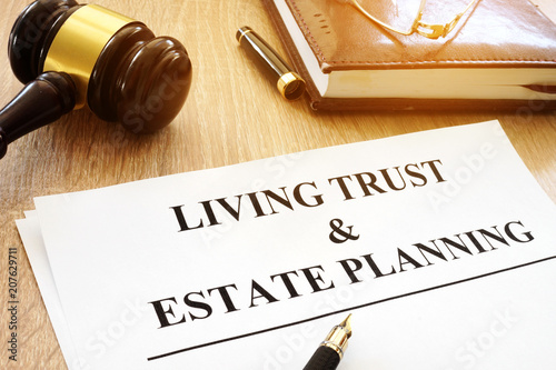 Photo  Living trust and estate planning form on a desk.