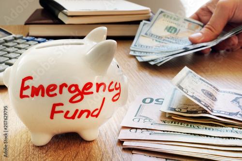Fototapeta Emergency fund written on a piggy bank. obraz