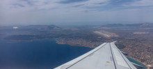 Plane Over Athens, Greece Airport. View Out Of Airplane Window.