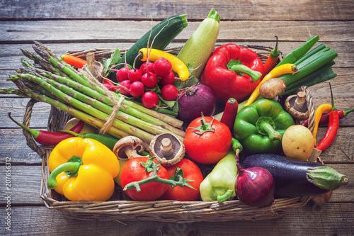 Foto op Plexiglas Groenten Basket full of healthy seasonal vegetables