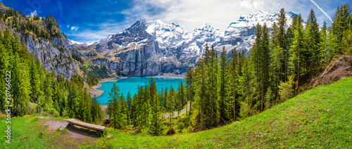 Deurstickers Weg in bos Amazing tourquise Oeschinnensee lake with waterfalls, wooden chalet and Swiss Alps, Berner Oberland, Switzerland