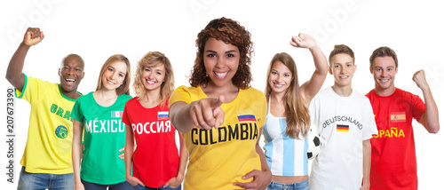 Fotomural Colombian soccer supporter with fans from other countries