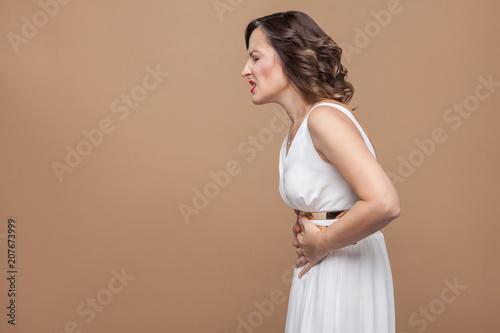 Valokuvatapetti Woman unwell. Have stomach pain