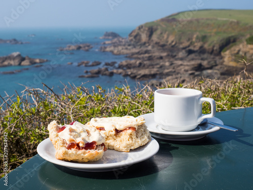 A traditional English cream tea including scones, jam and clotted cream by a coa Fototapete