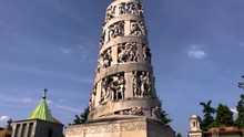 Tower With Sculptures And Statues Inside The Monumental Cemetery. Famous Tower Tomb Carved With Human Figures And Saints. Milan, Italy