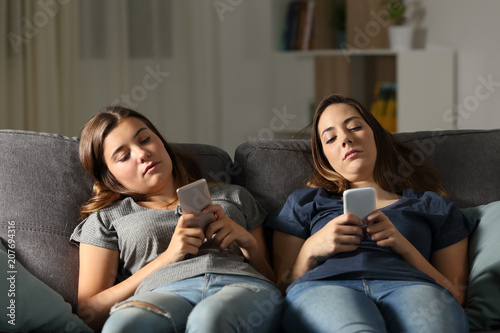 Bored friends using their smart phones Canvas Print