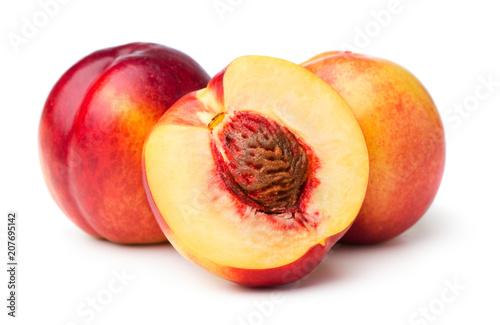 heap of nektarine peaches isolated on white background