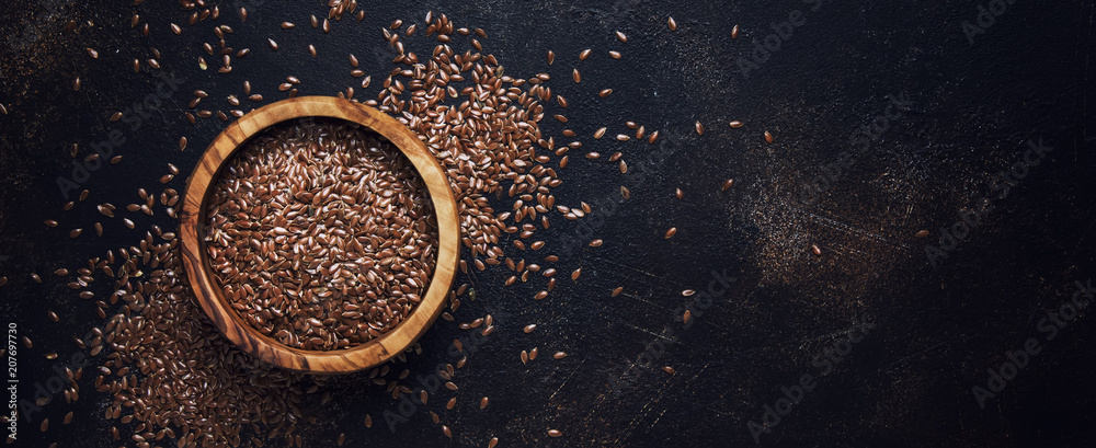 Fototapety, obrazy: Raw flax seeds in bowl, stone background, top view