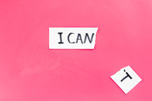 I Can Concept. Encourage Youself. The Letter T Cut Off Of Written Word I Can't. Pink Background Top View Copy Space