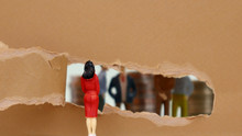 Torn Paper And Miniature People. Theconceptofgenderinequalityinthefieldofsociety.