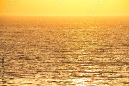 The sun setting over the Pacific Ocean off the coast of California Poster