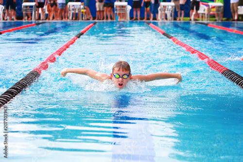 Boy swimming butterfly