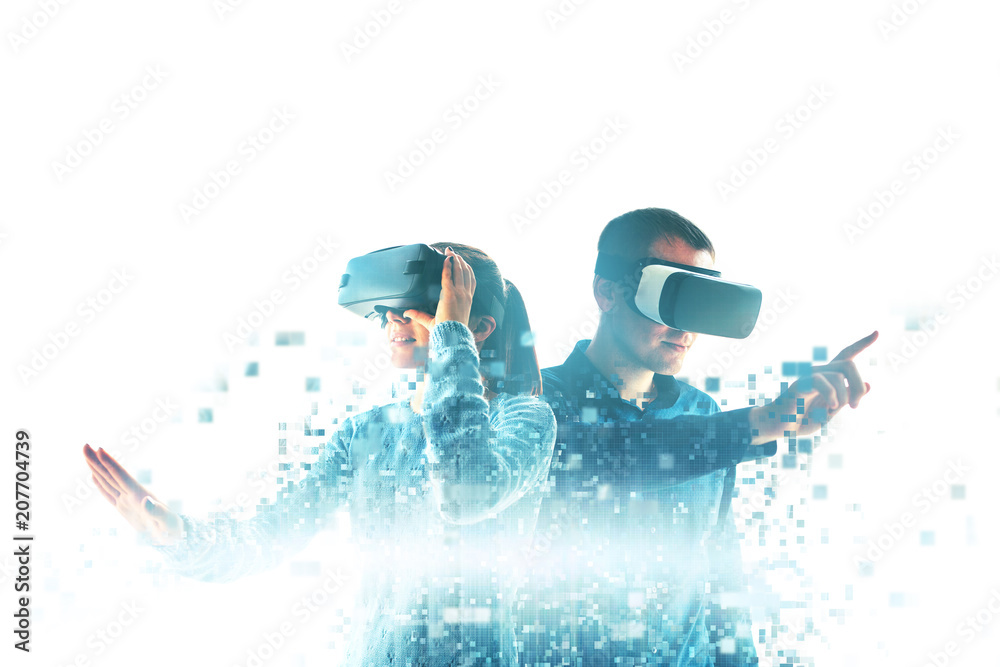 Fototapeta A young woman and a young man in virtual reality glasses are fragmented into pixels.The concept of modern technologies and technologies of the future. VR glasses.