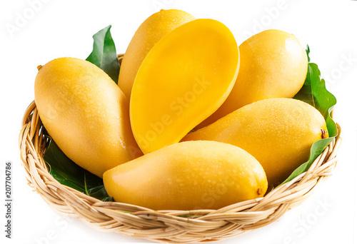 Yellow mango Beautiful skin In the basket In white background