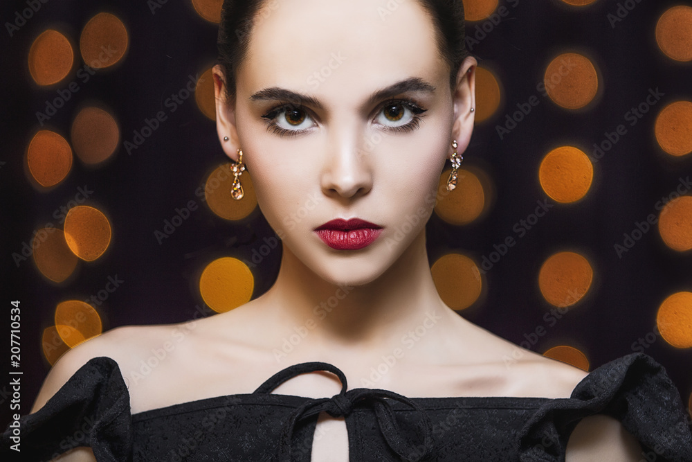 Fototapeta Model young brunette woman beautiful and luxurious portrait on gold lights background