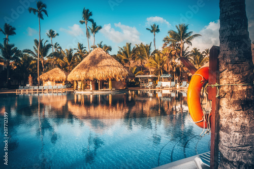 Canvas Prints American Famous Place Tropical swimming pool in luxury resort, Punta Cana