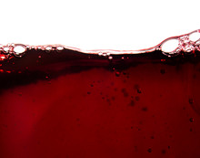 Bubbles In A Glass Of Red Wine...