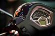 Modern motorcycle speedometer on dashboard showing kilometers per hour speed