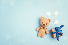 Toy Bear And Gift Box On A Blue Background With Copy Space. Top View, Flat Lay.