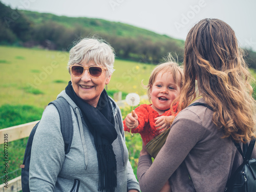 grandmother with daughter and grandchild outdoors buy this stock