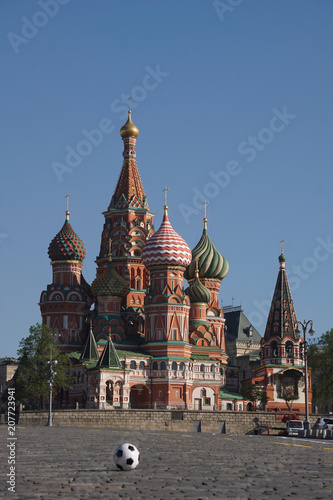 Fotobehang Moskou Moscow / Russia – 05.08.2018: vertical image of a soccer ball on the Red Square in Moscow in front of the Saint Basil's Cathedral