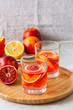 Citrus infused water with slices of fruits. Seasonal beverages concept