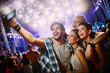 canvas print picture - Happy friends taking selfie at music festival