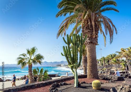 Tuinposter Canarische Eilanden boardwalk and coastline in Puerto del Carmen, Lanzarote, Spain