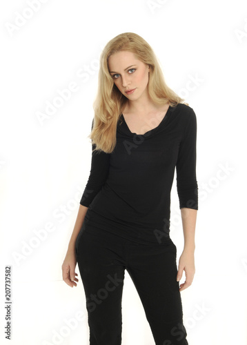 portrait of blonde girl wearing black shirt, on white studio background Canvas-taulu