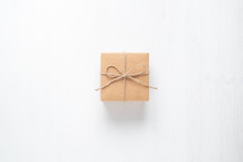 Gift Box Tied With String On A White Background