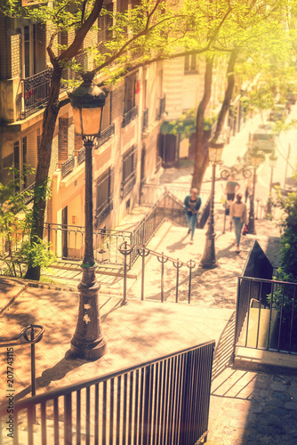 Keuken foto achterwand Centraal Europa Typical Montmartre staircase and old street lamp, golden sunny light in Paris France