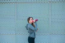 Portrait Of Young Sportswoman Woman With A Bottle Of Water