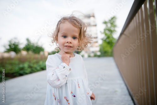 Portrait Of Beautiful Cute Little Girl With Curly Blonde Hair