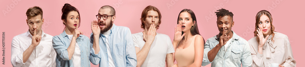 Fototapeta The young men and women whispering a secret behind hands over pink background