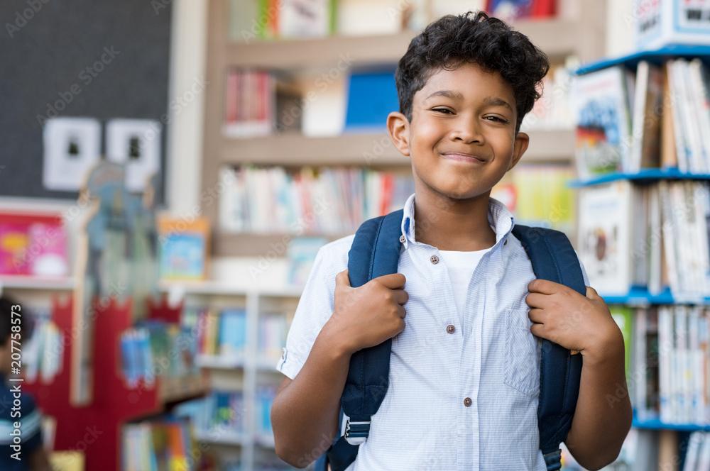 Fototapety, obrazy: Smiling hispanic boy at school