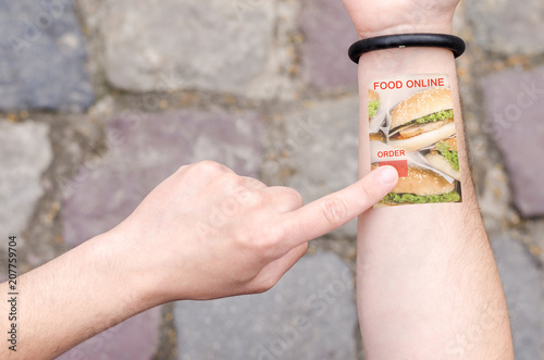 Food Delivery Order Online Grocery Wearable Projection Bracelet Smartphone Mobile Phone on Man Hand Invisible Tech technology Innovations Future Concept