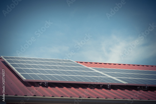 Vintage image solar panel on metal roof of commercial building at