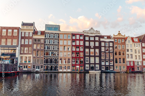 Poster Amsterdam Amsterdam's Domarque Canal with traditional houses at sunrise