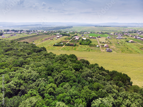 In de dag Lime groen village and forest, aerial view. Iasi Romania