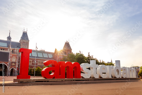 The sign i amsterdam in front of rijksmuseum in Amsterdam on sunrise Wallpaper Mural