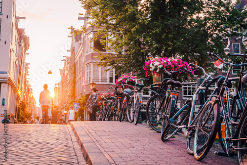 sunset on the streets and canals of Amsterdam Wallpaper Mural