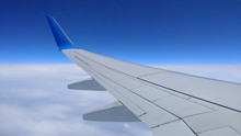 View Of A Gray Airplane Wing T...