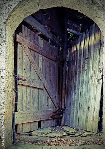 Fotografia, Obraz  door of a stable to access two different rooms using a single en