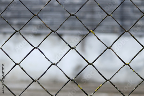 blurred abstract landscape grid fence metal grid texture background