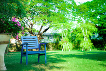 One Wooden Blue Chair Alone In The Garden. Feel Lonely, But Relaxing And Retirement