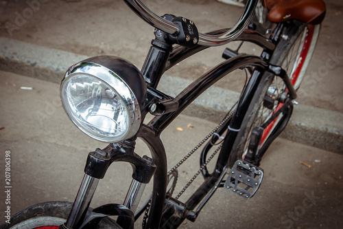 Foto op Canvas Fiets headlight on the frame of the bike.