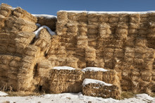 Stacks Of Hay Bales With Snow On Top