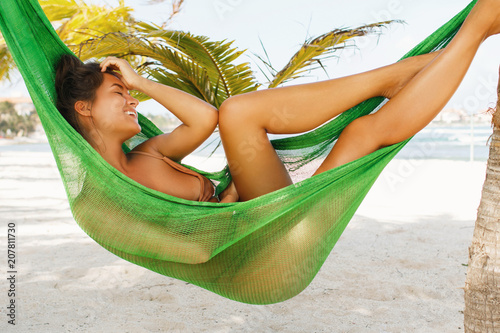 Photographie Happy and beautiful woman lying in the hammock