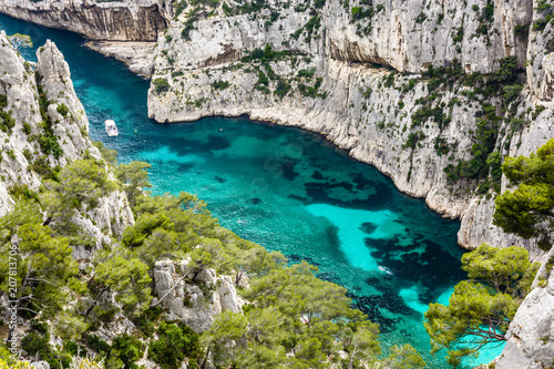 Bird's eye view of the calanque of En-Vau, a hard-to-reach natural creek with crystal clear water on the french mediterranean coast, part of the Calanques National Park between Marseille and Cassis.